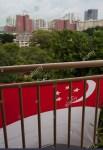 national-flag-in-a-social-housing-hdb-block-in-singapore-E6318C