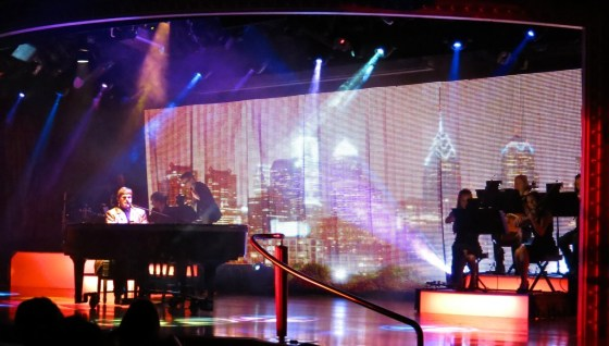 An Elton John impersonator aboard the Crystal Serenity looks and sounds amazingly like the Rocket Man himself.