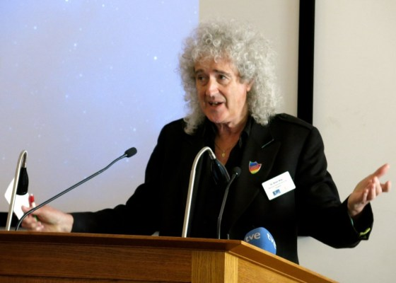 Brian May of Queen at a podium