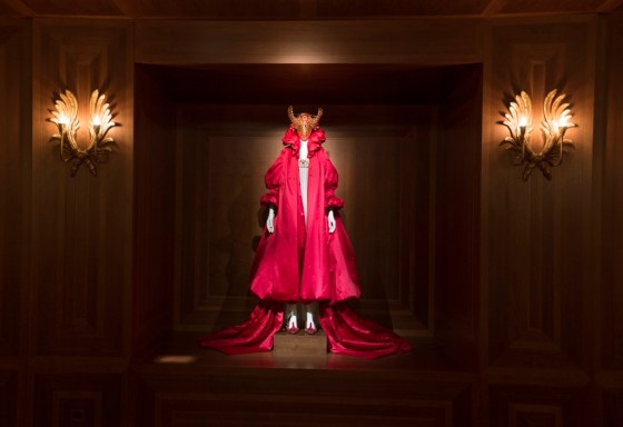 """A matador-like figure in a red robe and jeweled bull mask presides over the Romantic Nationalism gallery at the """"Alexander McQueen: Savage Beauty"""" exhibit at London's V&A."""