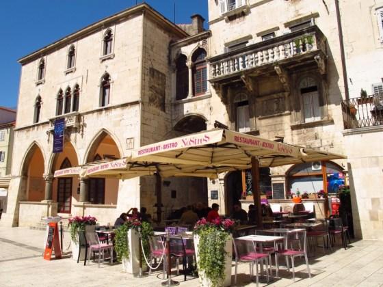 Venetian balcony overlooking a cafe in Split