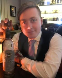 Riccardo Vecchio brandishing a bottle of Beluga Gold Vodka