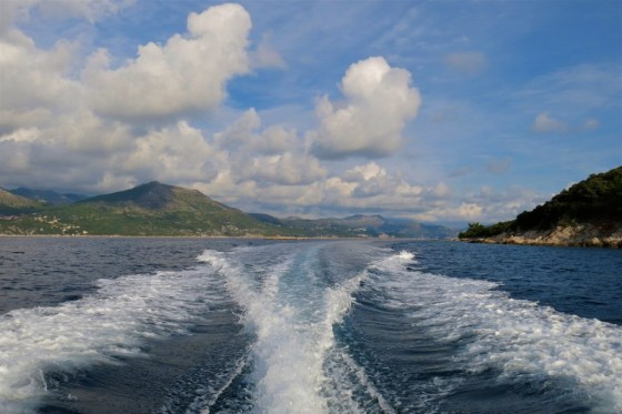 A speedboat leaves a frothing wake in the Adriatic Sea off Croatia's Dalmatian Coast.