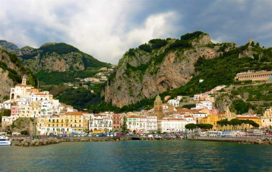 Amalfi, sandwiched between sea and stony bluffs, viewed from the ferry