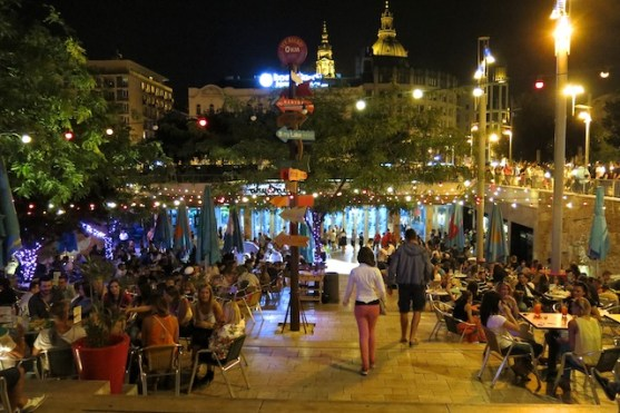 Crowds flank the terrace leading to Akvarium nightclub in Budapest's Erzsebet Square.