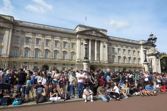 Tourists gather in front of Buckingham Palace in London. Copyright Amy Laughinghouse.