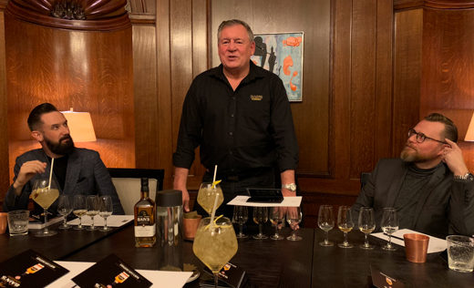 Neil Ridley (left), Andy Watts (centre), and Joel Harrison (right) discuss Bain's Cape Mountain Whisky at a tutored tasting.