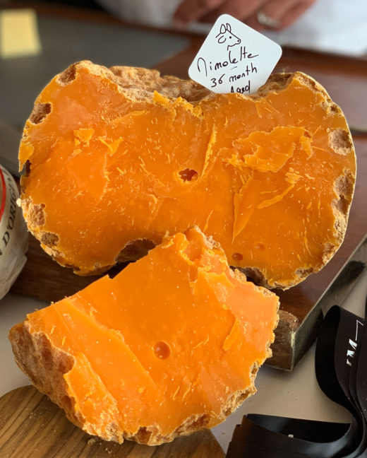 large chunk of Old Mimolette cheese