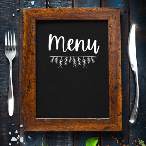 Photo of chalkboard menu between a fork and knife