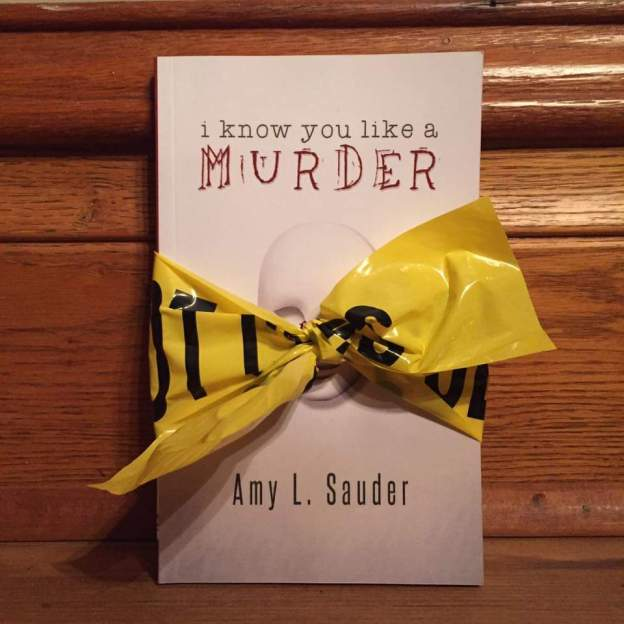 I Know You Like a Murder with crime scene tape bow