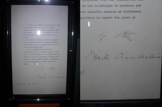 The actual piece of paper signed by Chamberlain and Hitler on the final day of their conference, which the British PM subsequently waved for the public to see upon his return home.  Their signatures can be seen in the close-up on the right (Hitler's on top).