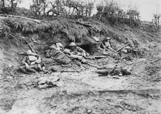 This photo was taken during the Third Battle of Ypres in 1917, part of WWI.  British dead can be scene laying in the mud amid those fighting.  Photo from the British Imperial War Museum