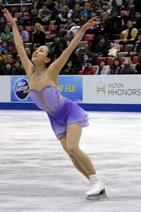 Mao Asada performs at 2013 Skate America. Photo by Wikipedia user David W. Carmichael