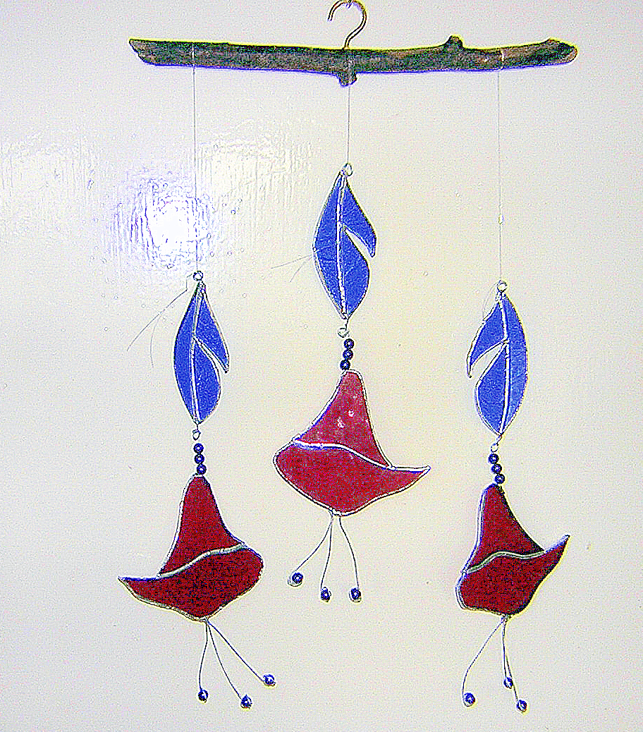 Red and blue stained glass flower and leaf motif