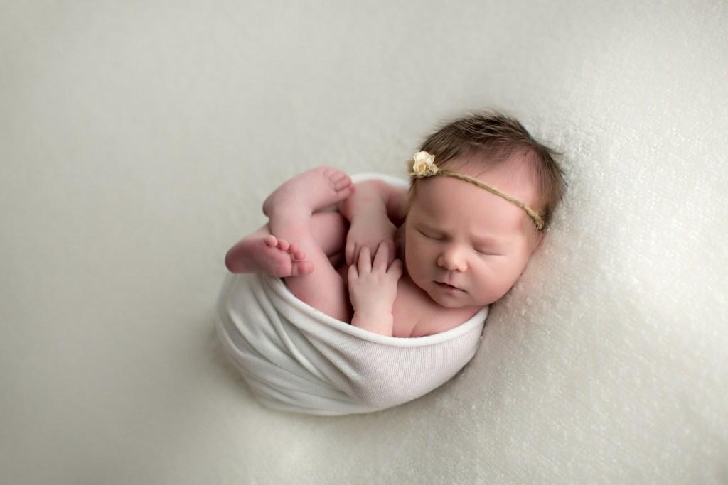newborn niece wrapped in white fabric