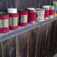 Cans on a fence- amy+mayd
