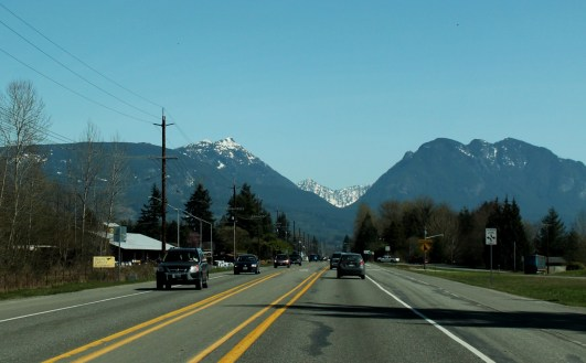 the journey across Highway 2 begins, blue skies and snow capped mountains encourage me on