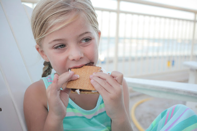 Little girl enjoying s'mores