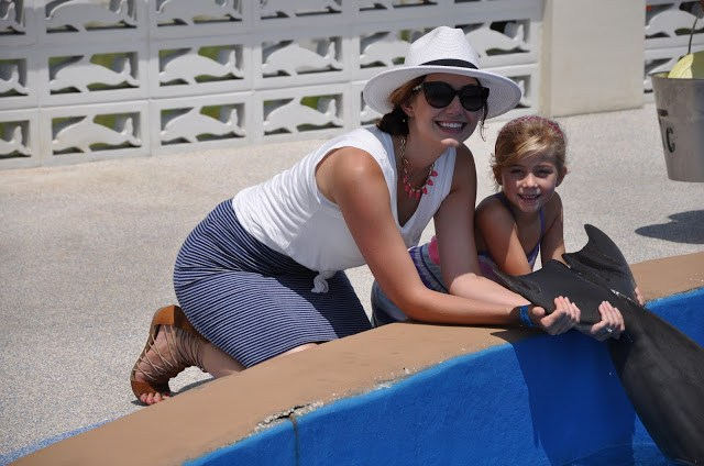 Amy West and daughter with dolphin