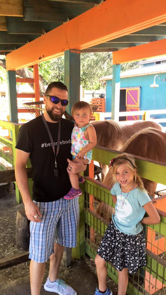 David West and daughters play at the Lowry Park Zoo petting zoo