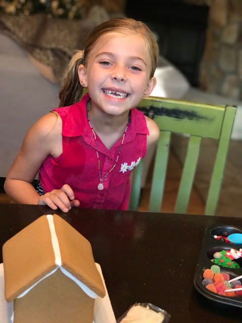 Sienna smiles as she starts her gingerbread creation.