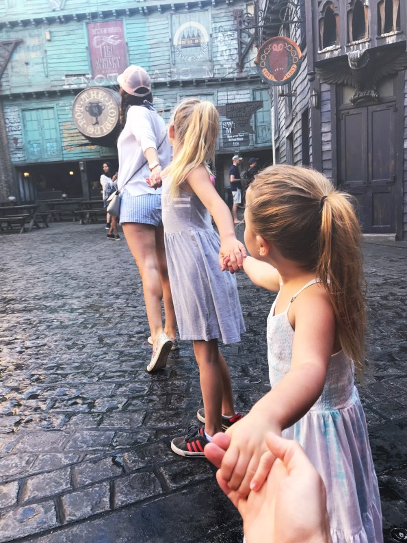Amy West and daughters walk through the Wizarding World of Harry Potter