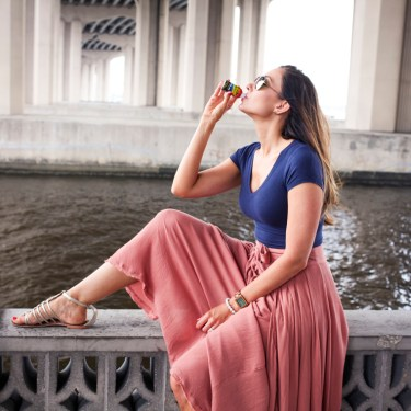 Woman drinking a 5 Hour Energy by the river in Jacksonville