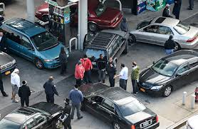 Cars converge on a gas station in Williamsburg, Brooklyn  photo Robert Stolarik for The New York Times