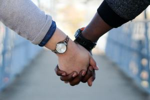 Interratial Couple Holding Hands - What Really Matters