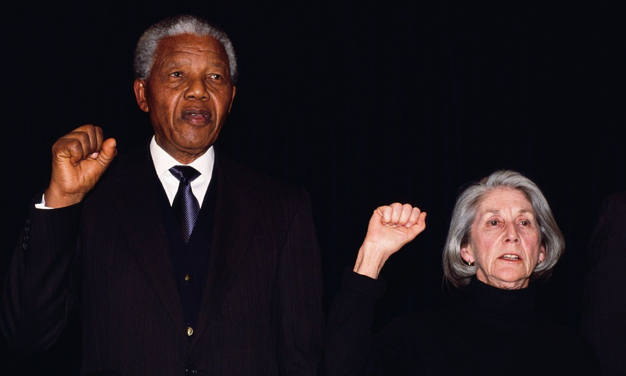 29 May 1993, Johannesburg, South Africa --- Johannesburg, South Africa: Nelson Mandela and author Nadine Gordimer sing National Liberation Anthem at Ghandi Memorial - Former President of South Africa and longtime political prisoner, held by the Apartheid based government from 1964-1990 for sabotage. With the coming of a freer political climate, Mandela was released from his life sentence at Victor Vester Prison on February 11, of 1990. He went on to lead the African National Congress in negotiations with President F.W. de Klerk, that resulted in the end of Apartheid and full citizenship for all South Africans. He and de Klerk received a joint Nobel Peace Prize in 1993 for their efforts. Mandela was elected president in 1994. --- Image by © Louise Gubb/CORBIS SABA