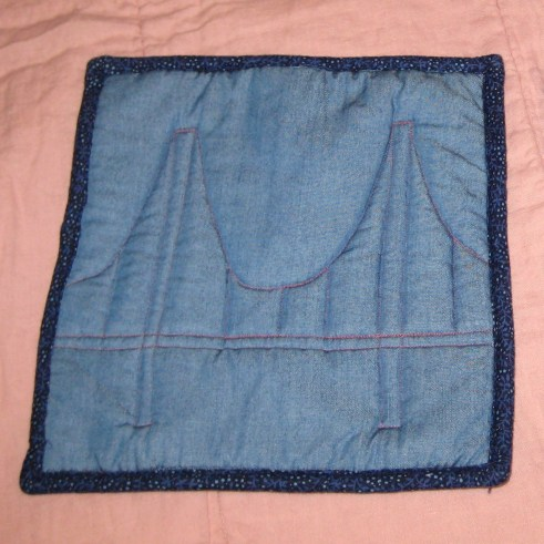Photograph of blue hot pad with quilted design of a suspension bridge