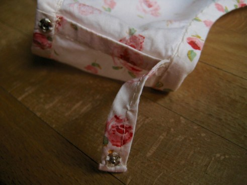 Detail photograph of bra strap holder inside shell