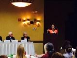 Nelba Speaking with Panel