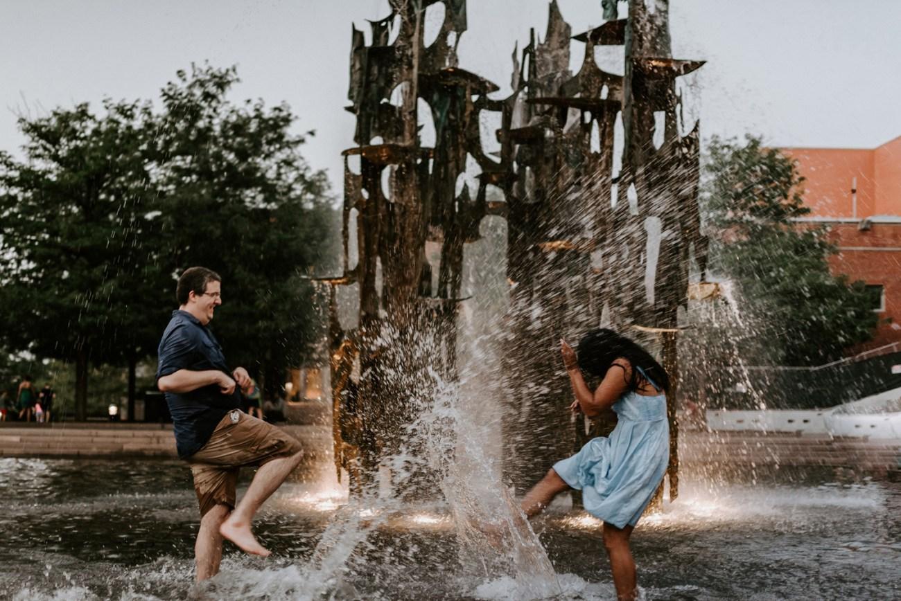 Couple having fun in the Princeton University Library fountain