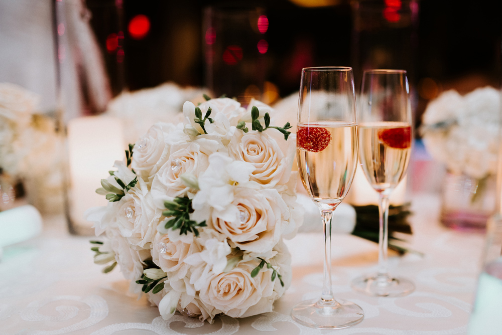 Wedding bouquet details with champagne glasses