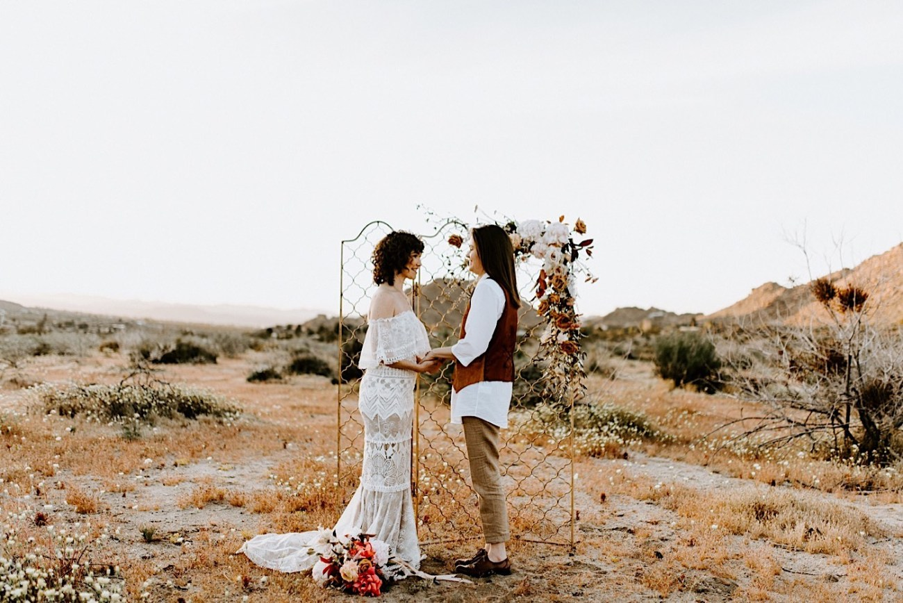 Elopement ceremony location in Joshua Tree. Bride and bride standing in Joshua Tree for their elopement ceremony. California elopement photographer. Palm Springs elopement photographer. Anais Possamai Photography