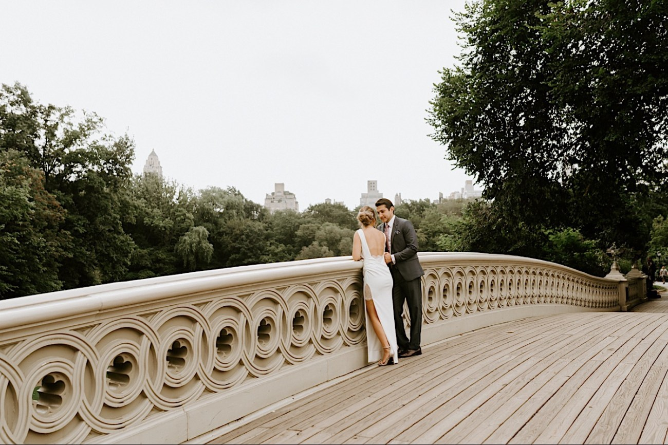 Bride and Groom walking on the Bow Bridge in Central Park, Anais Possamai Photography