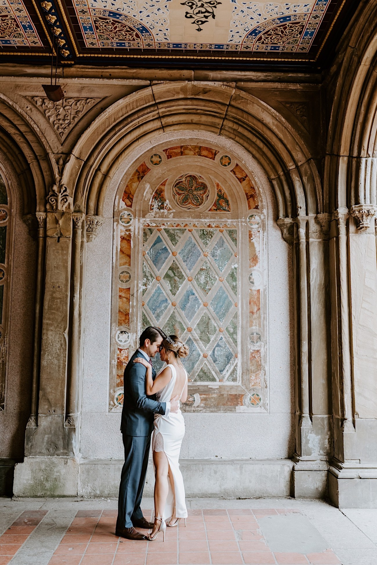 Bride and Groom standing by the Bethesda Terrace in Central Park, Wedding photos in Central Park, Anais Possamai Photography