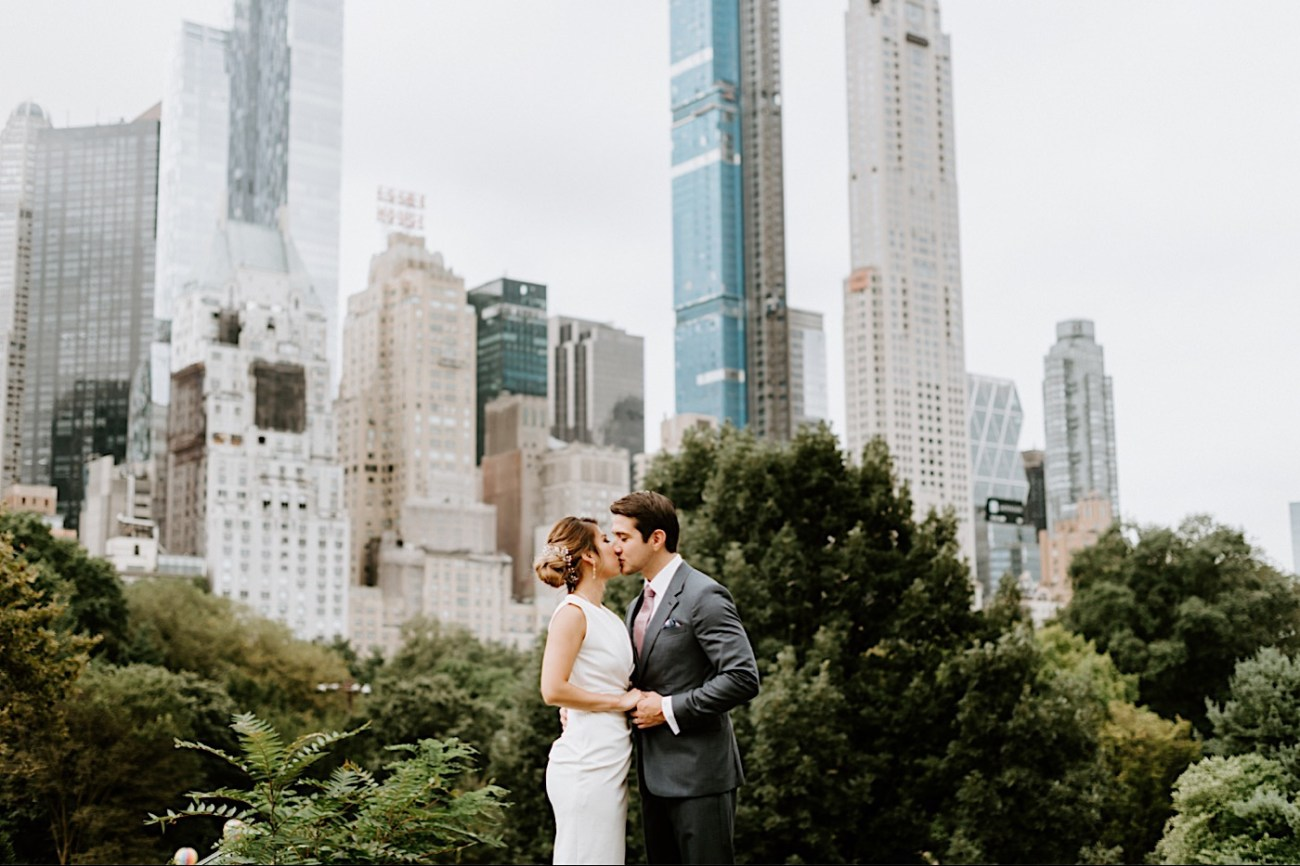 Bride and Groom kissing in front of the Manhattan Skyline in Central Park, Best views in Central Park for your elopement wedding portraits, Anais Possamai Photography
