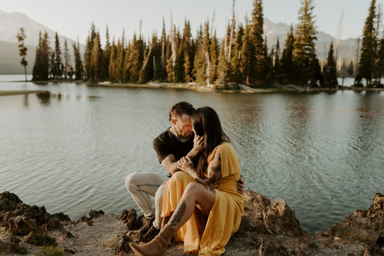 Couple sitting down at Sparks Lake Bend Oregon Elopement Bend Wedding And Elopement Photographer Anais Possamai Photography 004