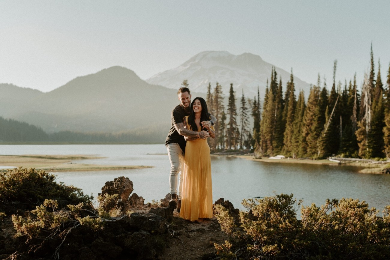 Couple walking by Sparks Lake for their couple session with South Sister in the background. Bend Oregon Elopement, Bend Wedding Photographer Anais Possamai Photography
