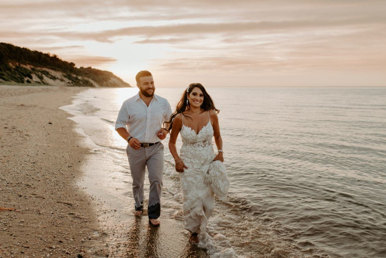 Bride and Groom running on the beach at Sunken Meadow State Park in Long Island for their sunset Wedding Bridal Portrait. New York Wedding Photographer. Anais Possamai Photography