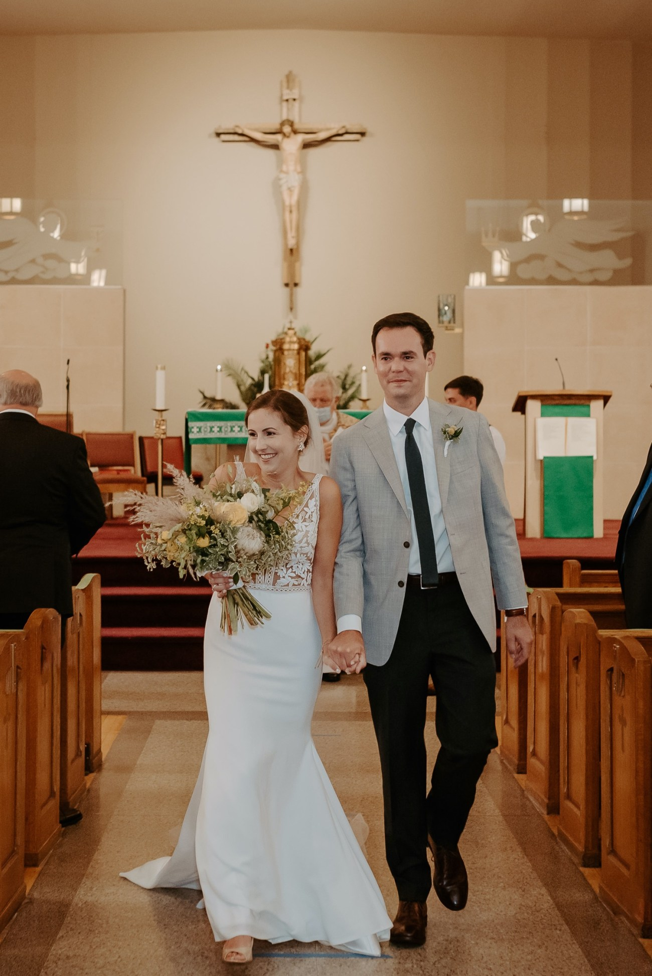 Bride and Groom walking down the aisle at their Church Ceremony in New jersey. Antique Loft Hoboken Wedding New Jersey Wedding Photographer Anais Possamai Photography 032