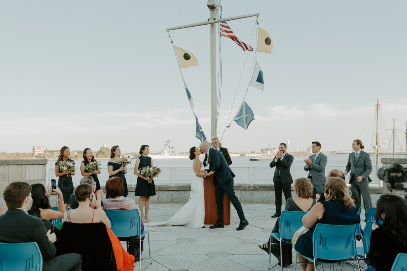 Bride and Groom first kiss during their ceremony at the Independence Seaport Museum Philadelphia Wedding Venue
