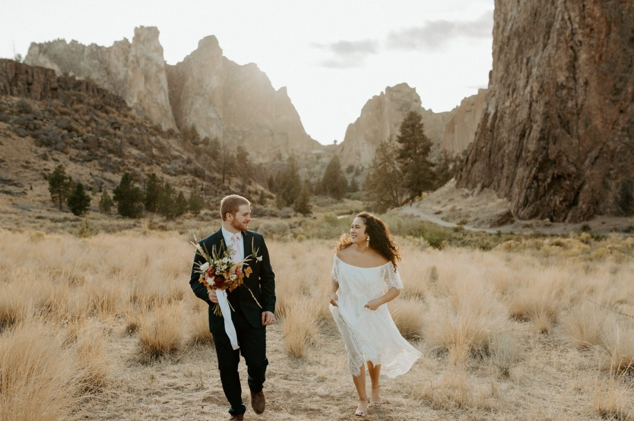 Bride and Groom walking in Smith Rock State Park for their elopement. Anais Possamai Photography