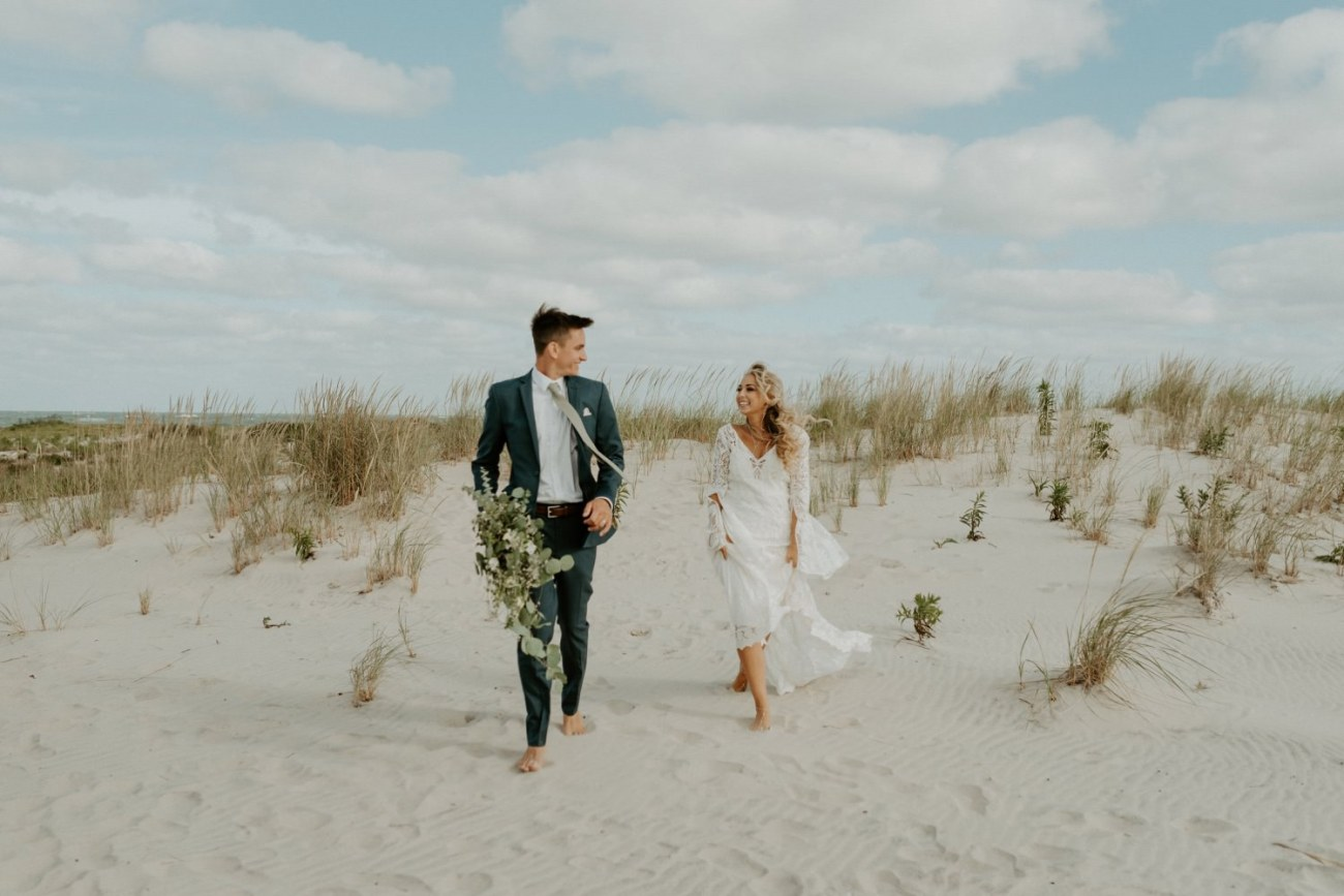Bride and Groom running on the beach for their bridal session in Long Beach Island New Jersey, Anais Possamai Photography