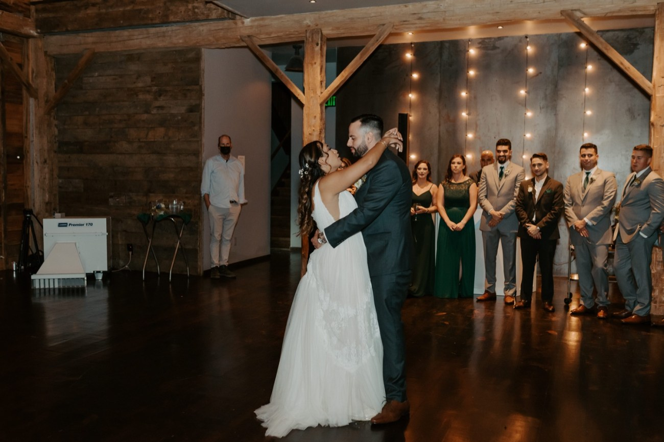 Bride and Groom during their first dance inside the barn at Handsome Hollow. Anais Possamai Photography