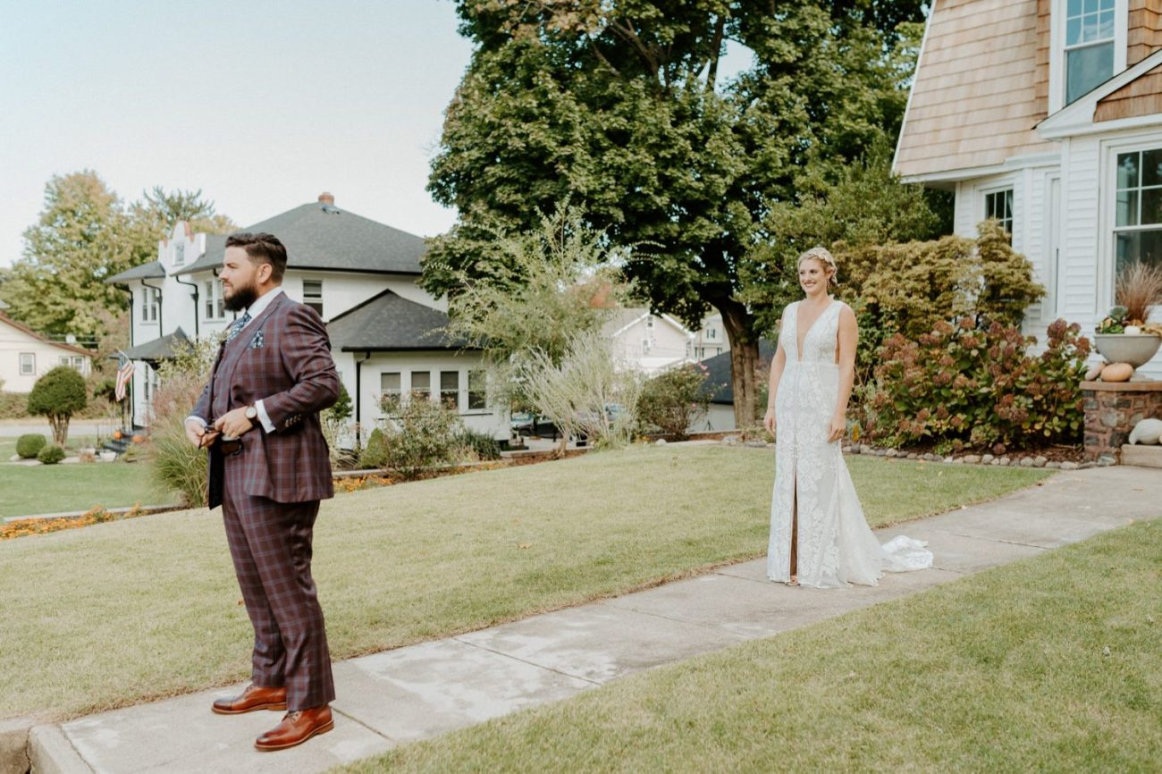 Bride and Groom first look for their fall backyard wedding in New Jersey