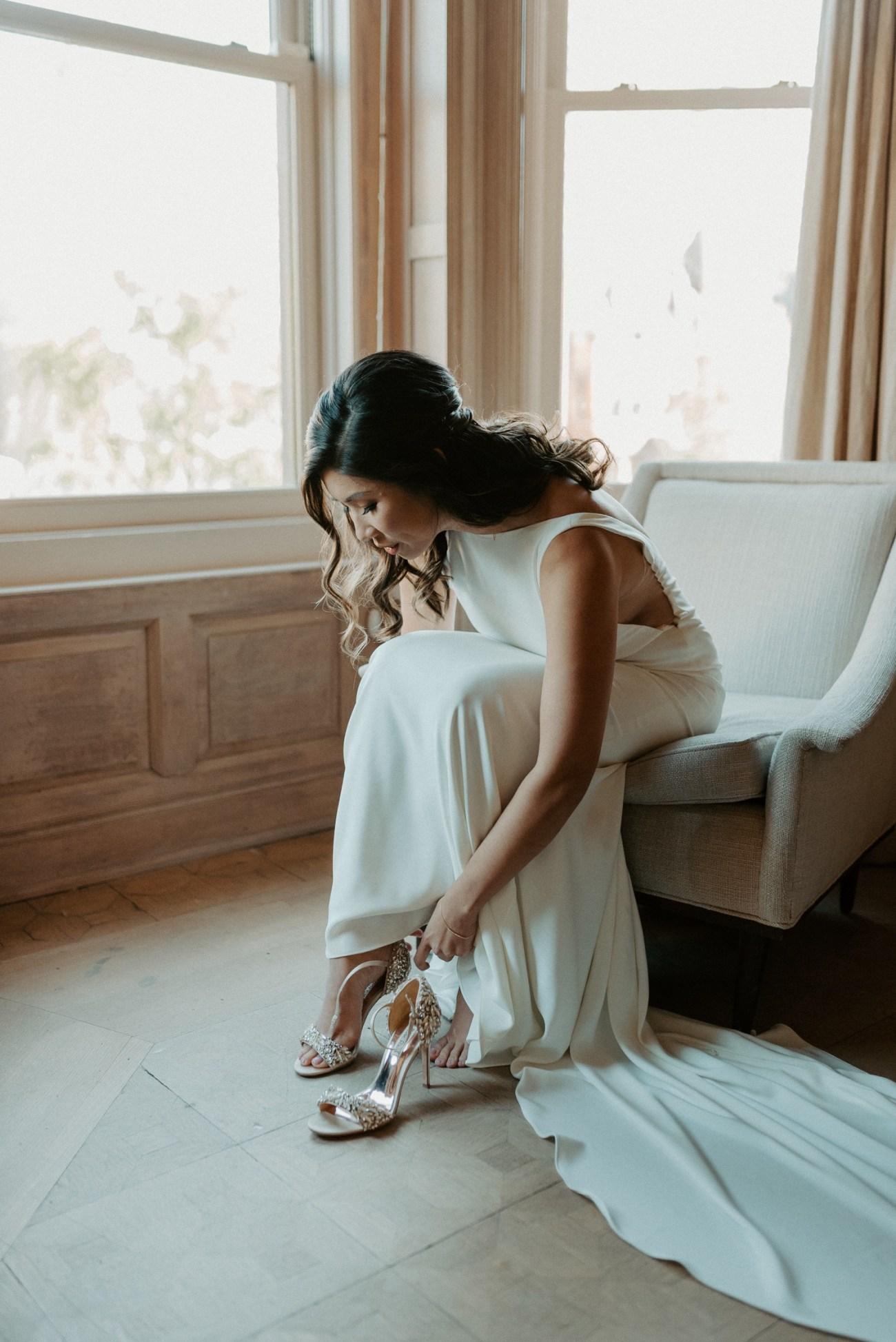 Bride getting ready in her Airbnb in Brooklyn for her Backyard Wedding