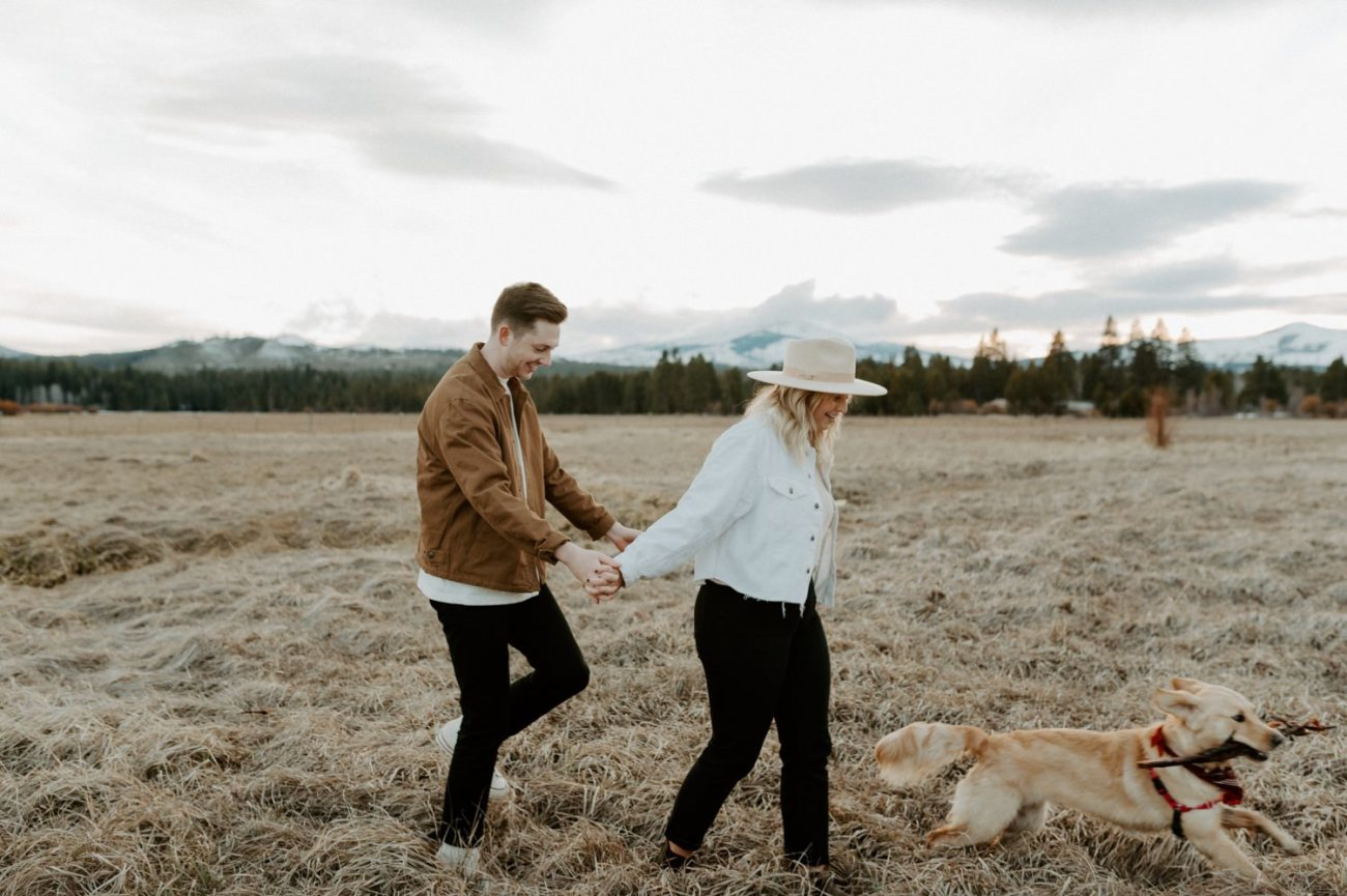 Couple walking around Black Butte Ranch in Sisters Oregon with their dog